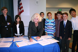Emily Andrade from EUSD School Board signing the end of year SWPPP documents